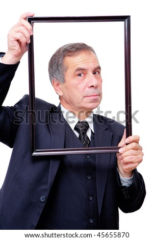 creative senior businessman with picture frame - stock photo