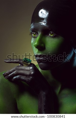 Creative shot with green body-art