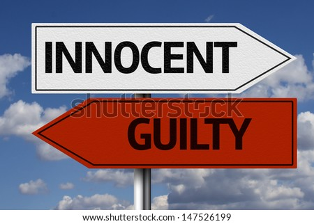 Creative sign with the message - Innocent, Guilty - stock photo