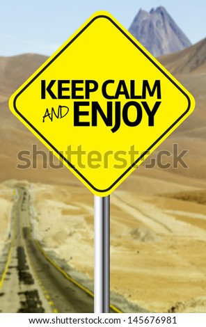 Creative sign with the message - Keep Calm and Enjoy - stock photo