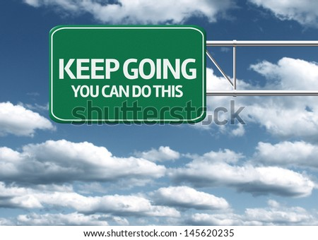 Creative sign with the message - Keep Going You Can Do This - stock photo