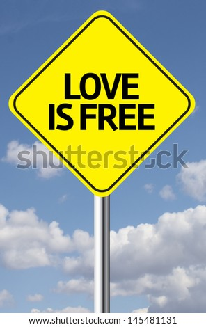 Creative sign with the message - Love is Free - stock photo