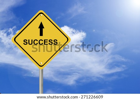 Creative sign with the message - success against beautiful blue sky - stock photo