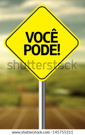 Creative sign with the message - Voce Pode (You Can in Portuguese) - stock photo