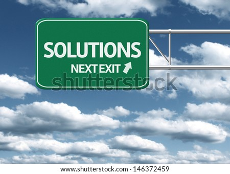 Creative sign with the text - Solutions, Next Exit - stock photo