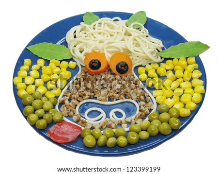 creative spaghetti food garnish with sausage cow shape - stock photo