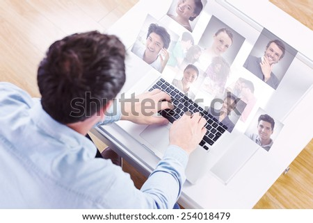 Creative team going over contact sheets in meeting against profile pictures - stock photo