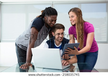 Creative team looking at digital tablet in the office - stock photo