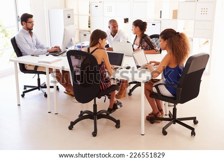 Creative Team Working In Office Of Start Up Business - stock photo