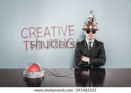 Creative thinking concept with vintage businessman and calculator at office - stock photo