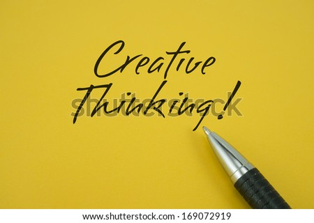 Creative Thinking note with pen on yellow background