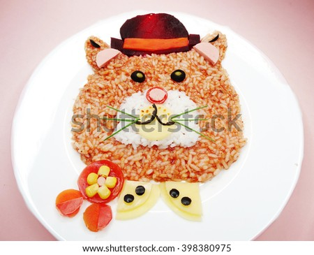 creative vegetable food meal with rice and sausage cat form - stock photo