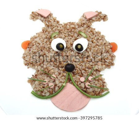 creative vegetable food meal with sausage dog form - stock photo