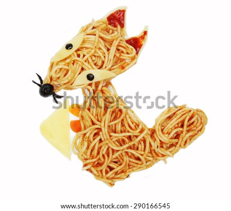 creative vegetable food meal with spaghetti fox form - stock photo