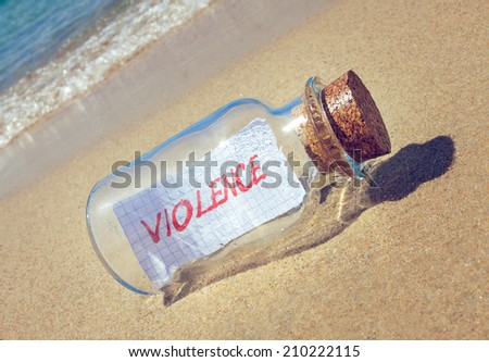 "Creative violence concept. Message in a bottle with text ""violence"""