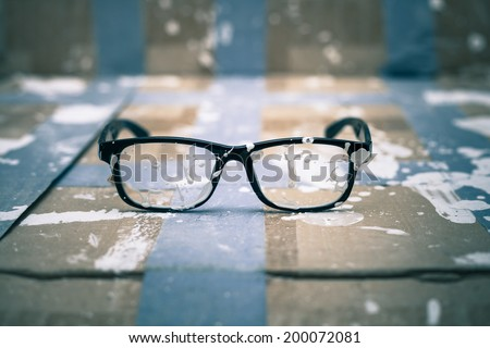 Creative vision conceptual photo, stained eyeglasses on paint background. - stock photo