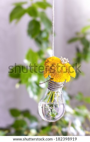 Creative wedding decoration - flowers in a light bulb - stock photo