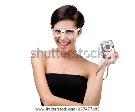 Creative woman holds amateur hand-held  silver camera, isolated on white - stock photo