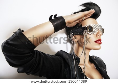 creative woman in glasses with chain - stock photo
