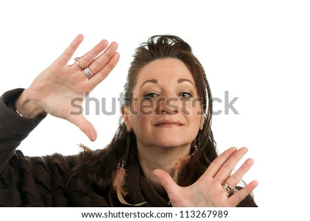 Creative woman with vision frames a scene with her hands isolated over a white background. - stock photo