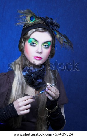 Creative young woman with vintage syringe. - stock photo