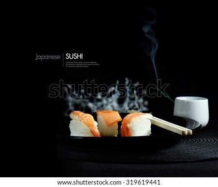Creatively lit fresh Japanese sushi against a black background. The perfect image for for your asian menu cover design. Accommodation for copy space. - stock photo