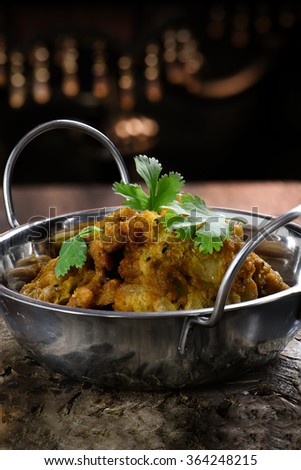 Creatively lit Indian Onion Bhajis against a dark, rustic styled background. The perfect image for your indian menu cover design. Generous accommodation for copy space. - stock photo