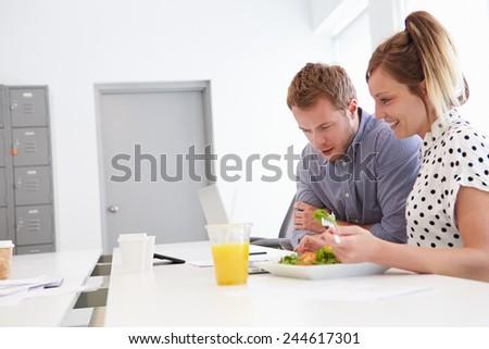 Creatives Having Working Lunch In Design Studio - stock photo