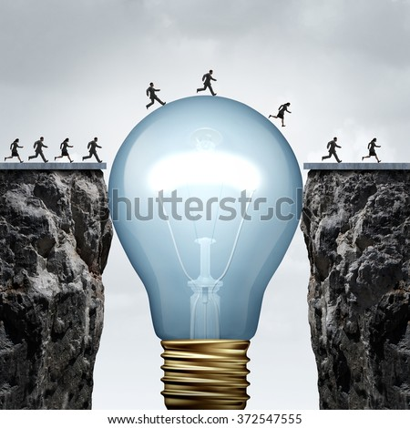 Creativity business idea solution as a group of people on two divided cliffs being connected by a giant light bulb creating a bridge to enable a crossing to success as a creative thinking metaphor.