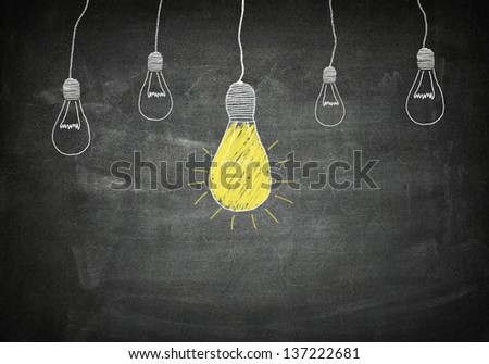 creativity concept for good ideas on blackboard - stock photo