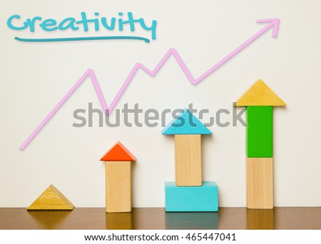 Creativity concept rising graph on block educational toy. Colorful baby education toy for learning and develop great creativity.