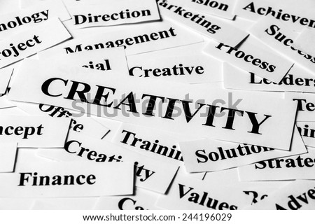 Creativity concept with some related words paper. - stock photo