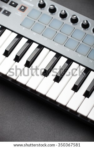 creativity.fragment of sythesiser keyboard. production of electronic music. - stock photo