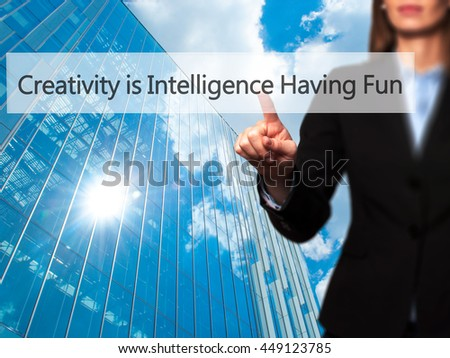 Creativity is Intelligence Having Fun -  Successful businesswoman making use of innovative technologies and finger pressing button. Business, future and technology concept. Stock Photo