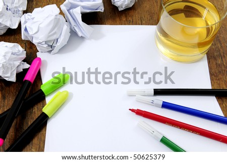 creativity problems: blank paper on desk with many paperballs  and whiskey - stock photo