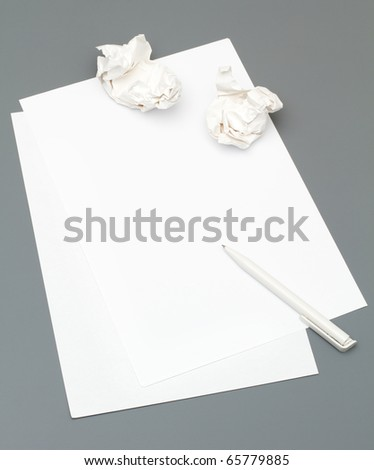 Creativity problems: Blank paper with white pen on gray background - stock photo