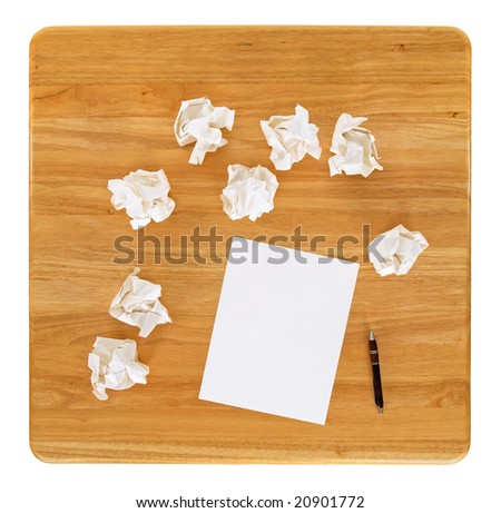 Creativity problems. Blank sheet of paper and crumpled paper wads. - stock photo