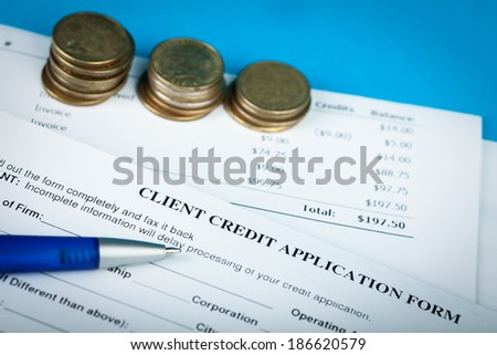 credit application with pen and money