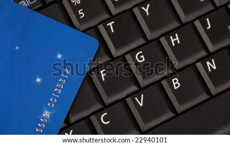 credit car on computer keyboard - stock photo