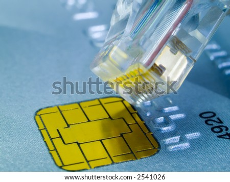 Credit card and a network cable representing online shopping.