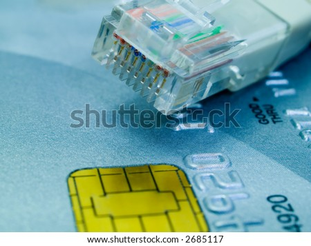 Credit card and a network cable representing online shopping. Shallow DOF. - stock photo