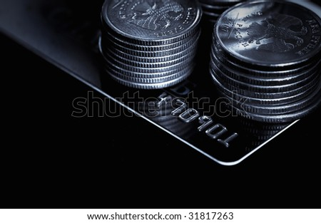credit card and coins - stock photo