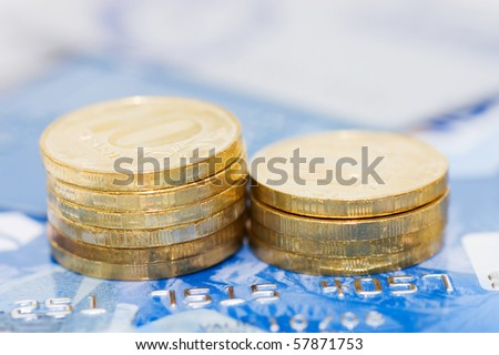 credit card and coins as a background - stock photo