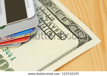 Credit card and 100 dollar close-up - stock photo