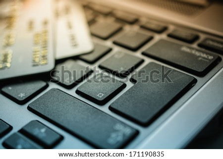 credit card and laptop keyboard - stock photo