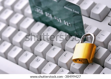 Credit card and lock on the keyboard.Financial security concept. - stock photo
