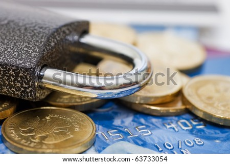 credit card and lock - security concept - stock photo