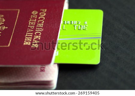 Credit card and passport on a black background - stock photo