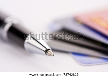 Credit card and pen - stock photo