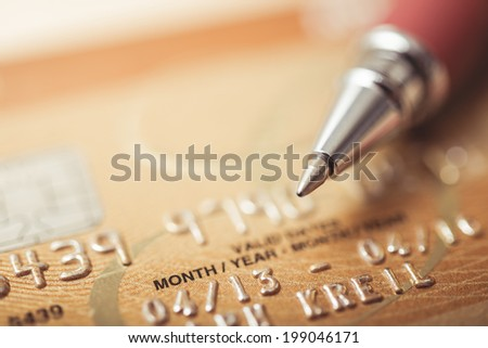 Credit card and pen up close